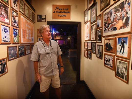 """After 37 years, The Downtown Lounge owner Pat Riley is ready to sell. Riley walks through the """"hall of fame,"""" a hallway to the bar that displays much of his memorabilia collection."""