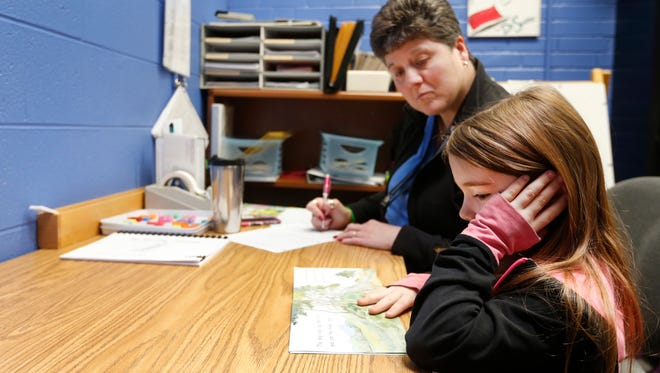 First grader Madison Jenkins works with reading specialist Sharon Chesler on an assessment at William Elementary School on Thursday, Apr. 28, 2016.