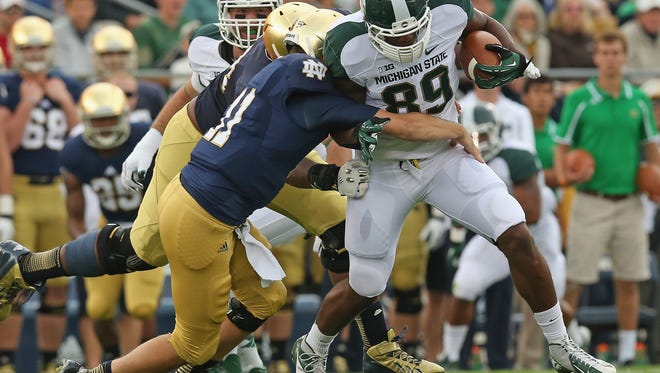 Michigan State defensive end Shilique Calhoun. No. 89, tries to break away from Ishaq Williams, No. 11, of the Notre Dame Fighting Irish at Notre Dame Stadium on September 21, 2013 in South Bend, Indiana. Notre Dame defeated Michigan State, 17-13.