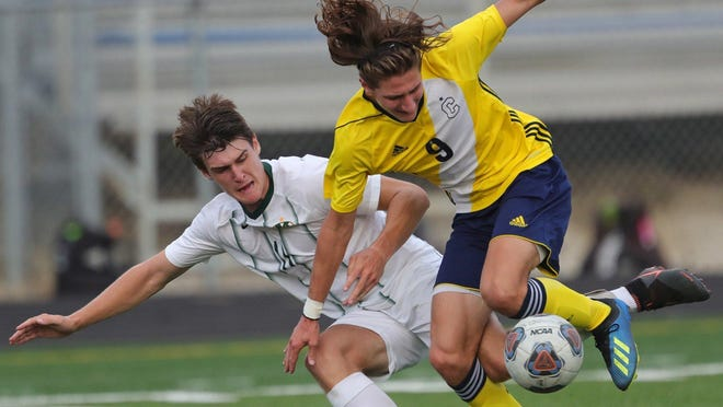 Copley's Sam Harter, right, gets tangled up with Medina's Steve Samuelson during the first half of a soccer game, Wednesday, Sept. 2, 2020, in Copley, Ohio.
