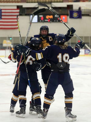 Wausau West Warriors players celebrate after a goal against the West Salem Panthers in a quarterfinal match at the 2017 State Hockey Tournament at Veterans Memorial Coliseum on Thursday, March 2, 2017, in Madison, Wis. 