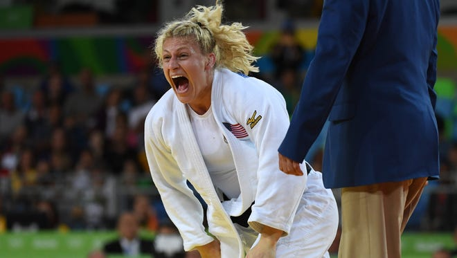 Kayla Harrison celebrates after defeating Audrey Tcheumeo of Brazil in the women's 78kg gold medal judo contest at Carioca Arena 2 on Thursday.