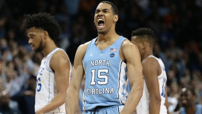 North Carolina Tar Heels forward Garrison Brooks (15) reacts after his team's 74-69 victory over rival Duke in the Atlantic Coast Conference semifinals Friday.
