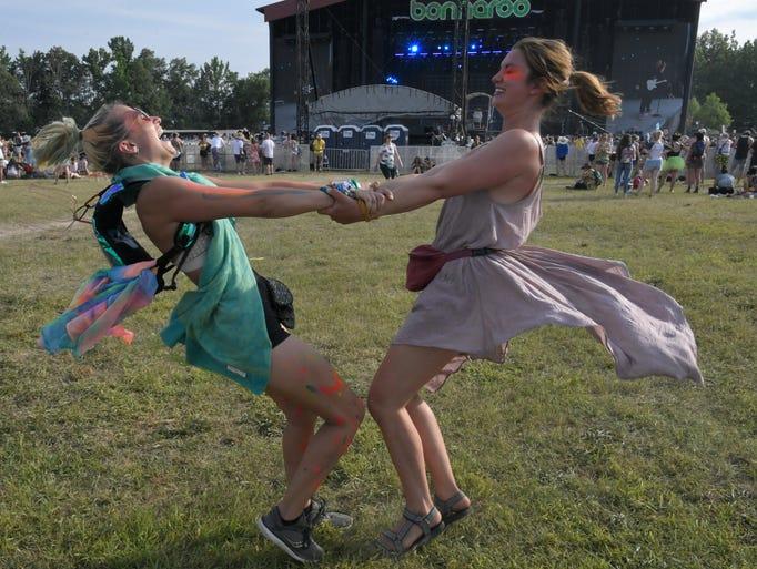 Brigitte Kolibab and Maggie Woolworth dance  holding