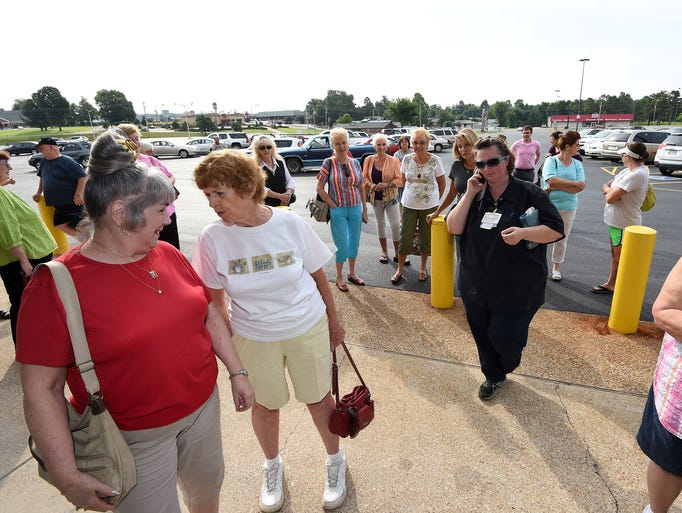 Dozens of people wait for Hobby Lobby to open its doors for the first time Thursday morning.