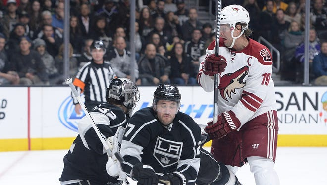 Arizona Coyotes right wing Shane Doan (19) takes a penalty for interference on this hit on Los Angeles Kings defenseman Alec Martinez (27) in front of goalie Jonathan Quick (32)  in the second period of the game at Staples Center in Los Angeles on Dec. 20.