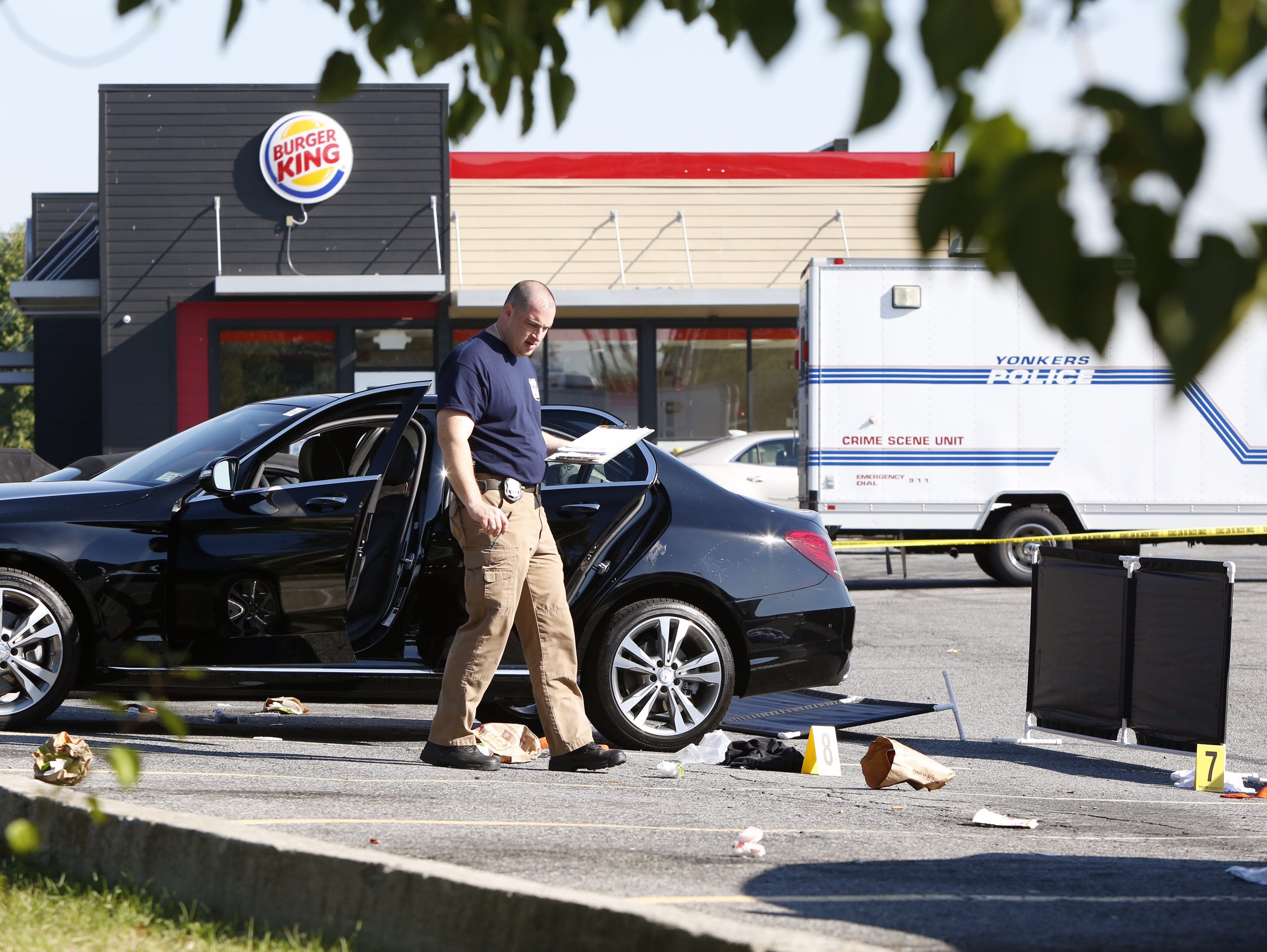 Yonkers police investigate the scene of a shooting in the Burger King parking lot in Yonkers on Sept. 18, 2015. Mike Nolan, a 23-year-old left-handed pitcher drafted last year by the Oakland A's, was shot just after 12:30 a.m. Friday, Sept. 18, 2015 in the parking lot of the Burger King near the Cross County Shopping Center in Yonkers, officials said.
