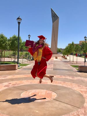 Donned in her honorary AAUW chords, 2016 scholarship recipient Chloe Lichtenberg celebrates after receiving her bachelor's degree in Spanish.