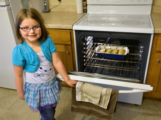 Kaitlyn Reichel, 6, poses Monday, Oct. 26 with the