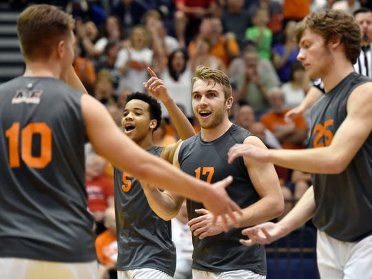 Northeastern's Matt Schaeffer, Taemar Willis, Reese Devilbiss and Dakoda Hoffman celebrate after winning the third game of the PIAA District 3 Class AA boys' volleyball title match Friday, May 27, 2016, at Dallastown. Northeastern swept York Suburban 3-0 (25-19, 25-11, 25-22) for the Bobcats' fourth consecutive district championship. Northeastern has won seven of the last eight district titles, and will compete for its fourth consecutive state championship.