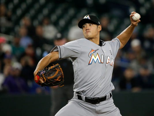 Miami Marlins starting pitcher Wei-Yin Chen throws against the Seattle Mariners during the first inning of a baseball game, Tuesday, April 18, 2017, in Seattle. (AP Photo/Ted S. Warren)