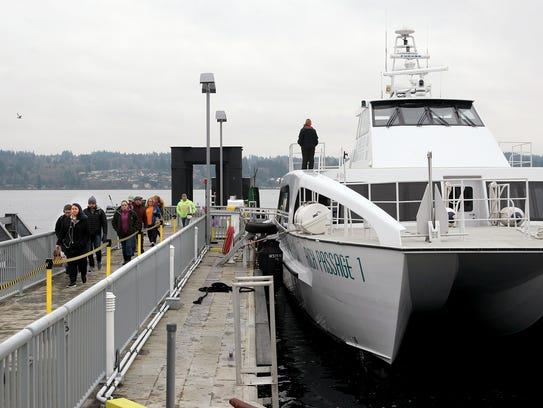 Passengers depart from the Kitsap Transit passenger ferry Rich Passage 1 in Bremerton on Wednesday. Passengers concerned that double-bookings could cause problems in January led Kitsap Transit to discover several runs were reserved beyond capacity.