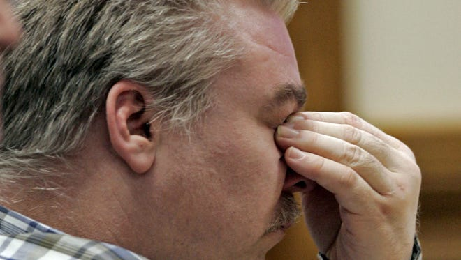 Steven Avery listens to opening arguments in a Calumet County courtroom during the opening day in his murder trial on Feb. 12, 2007, in Chilton.