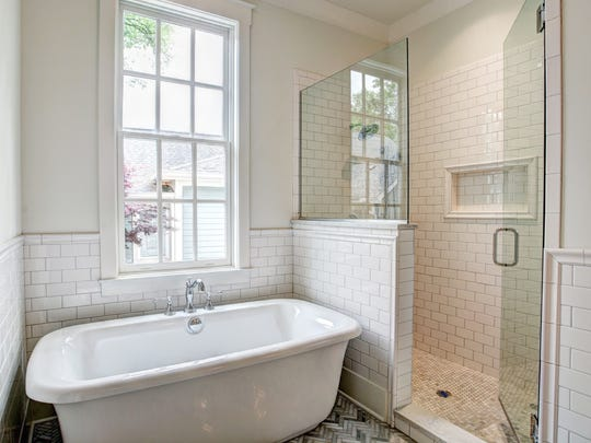 Home owners love the historical integrity of a Garden Gate Homes house but also need classic interiors with fresh finishes like the master bath of the Adams Street home.