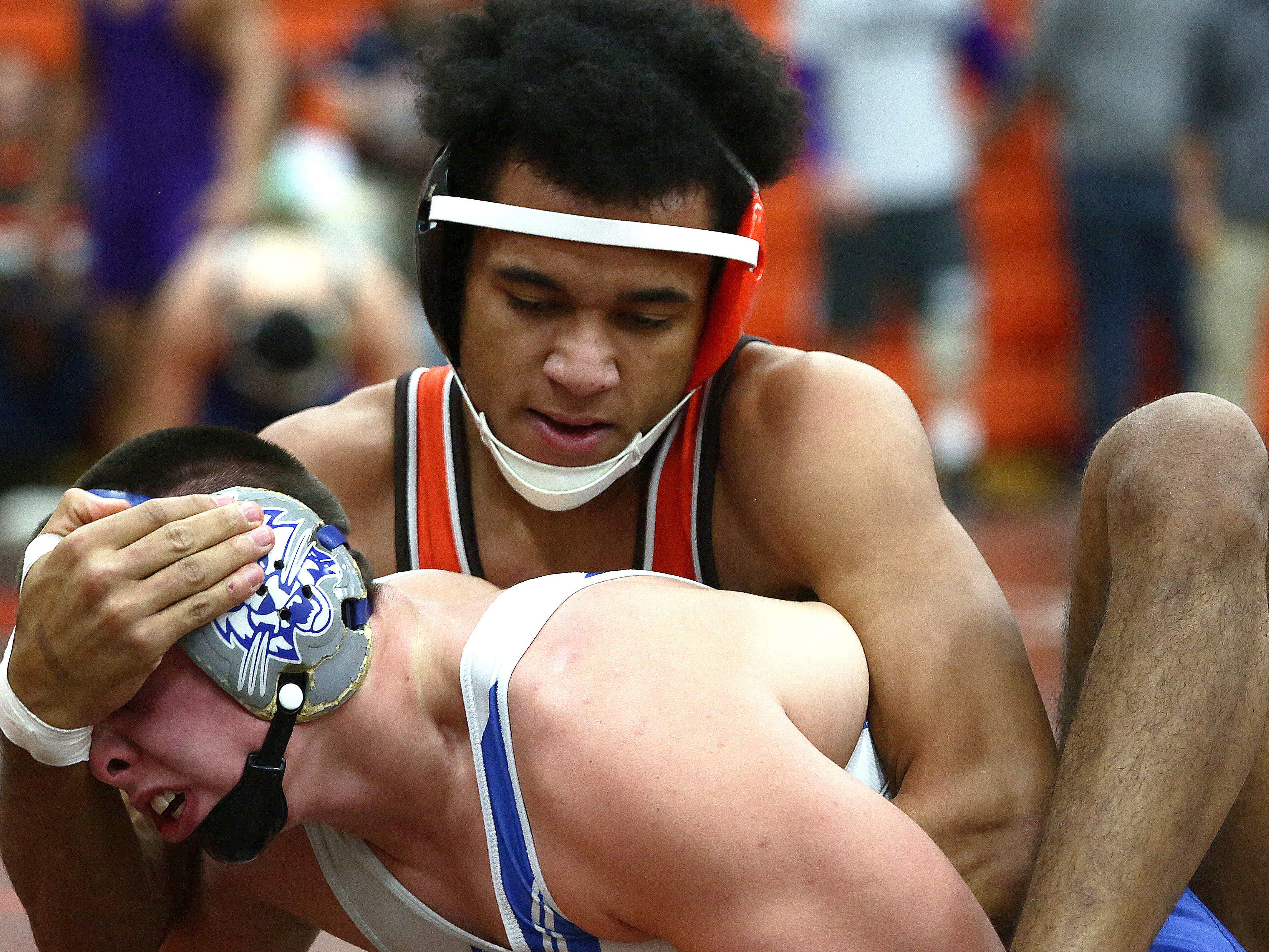 Deondre Williams of Mansfield Senior's Deondre Williams wrestles with Cambridge's Logan Hickenbottom of Cambridge during Friday's opening session of the 53rd J.C. Gorman Invitational.