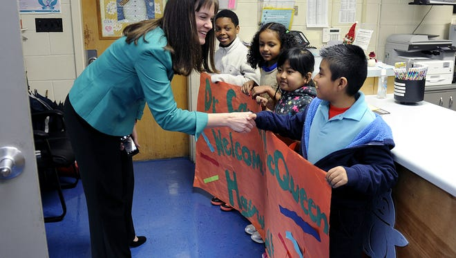 Haywood Elementary third-graders DaShawn McKissick, left, Yodit Delelegn, Ning Dim and Daniel Mondragon greet Tennessee Education Commissioner Candice McQueen on March 9, 2015.