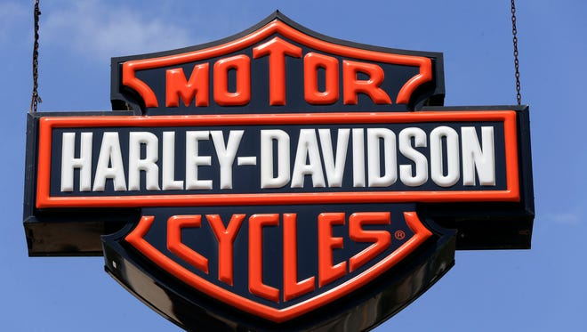 This April 26, 2017, photo shows dealership signs at a Harley-Davidson dealership in Glenshaw, Pa.  Under pressure from U.S. safety regulators, Harley-Davidson is recalling nearly 175,000 motorcycles because the brakes might fail. The U.S. recall covers more than 30 models from the 2008 through 2011 model years. Harley says deposits can form on brake parts if the fluid isn't changed every two years as specified in the owner's manual.  That can cause a valve in the antilock brake control unit to stick.