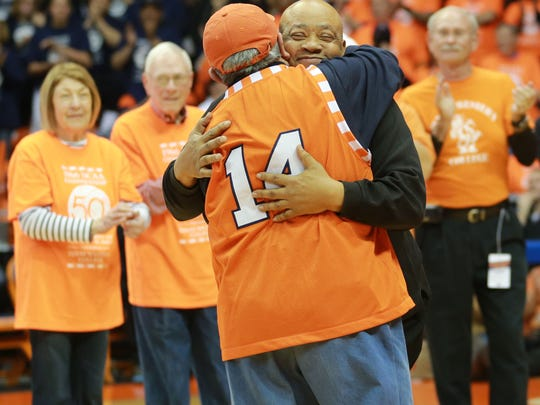 Willie Worsley of the 1966 Texas Western championship team embraces longtime fan Joe Gomez as he is introduced Saturday. Gomez and others in a receiving line were students at the time.
