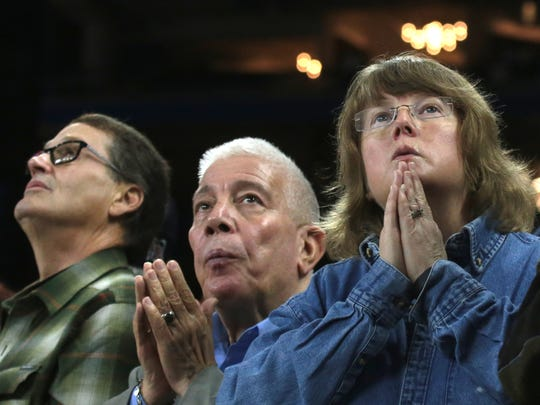 People in the crowd of thoushands watch the Beatification of Father Solanus Casey at Ford Field in Detroit on Saturday November 18, 2017.