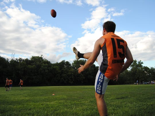 Adrian Sitler practices his kicking July 14 for Aussie Rules Football.