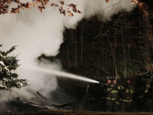 Somers firefighters work at the scene of a fatal house