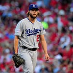 Oct 7, 2014; St. Louis, MO, USA; Los Angeles Dodgers starting pitcher Clayton Kershaw walks to the dugout during game four of the 2014 NLDS baseball playoff game against the St. Louis Cardinals at Busch Stadium. Mandatory Credit: Jeff Curry-USA TODAY Sports