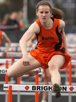 Brighton's Erin Dowd broke the school record in the 100, but finished second to teammate Shannon McGrath during the Bulldogs' victory at Pinckney on Tuesdsay.