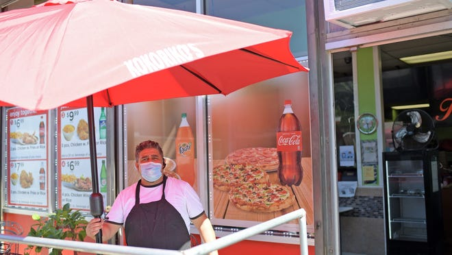Wilmar Franco outside his Main Street shop Tuesday.  Kokorikos Pizza has participated in a city program that provides restaurants' hot meals to COVID-19 patients and their families, and collectively, has delivered more than 3,000 meals..