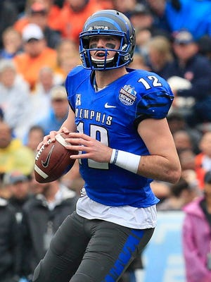 Memphis Tigers quarterback Paxton Lynch (12) looks down field during the game against the Auburn Tigers in the 2015 Birmingham Bowl at Legion Field.