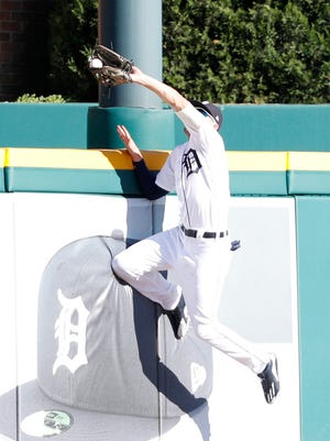 Detroit Tigers center fielder JaCoby Jones (21) jumps at the wall to make a catch for an out during the sixth inning against Texas Rangers third baseman Adrian Beltre (not pictured) at Comerica Park on July 7, 2018.