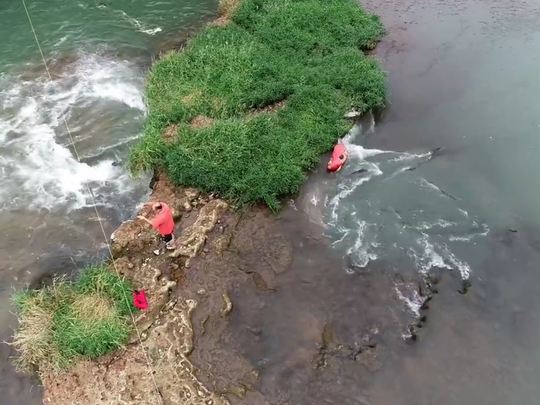 Aerial view of the whirlpool, right, gushing out from