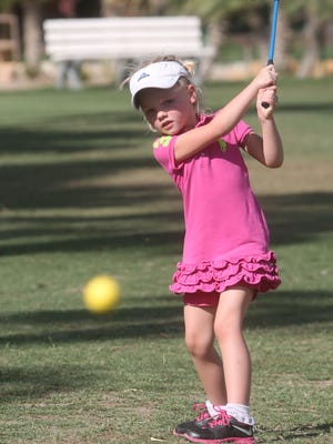 Vanessa Vorwald, 5, practices her golf game at Shadow Mountain Resort and Club in Palm Desert as part of a camp. The camp is run by PGA professional and instructor Sharon Fletcher.