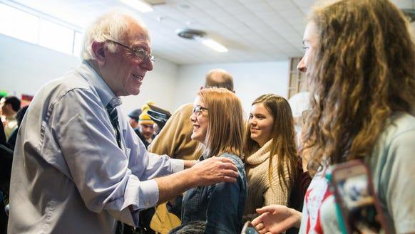 Democratic presidential candidate Bernie Sanders greets