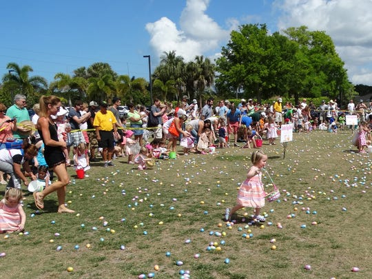 Young, really young, members of the community try to decide where to load up during the annual Easter jubilee egg hunt.