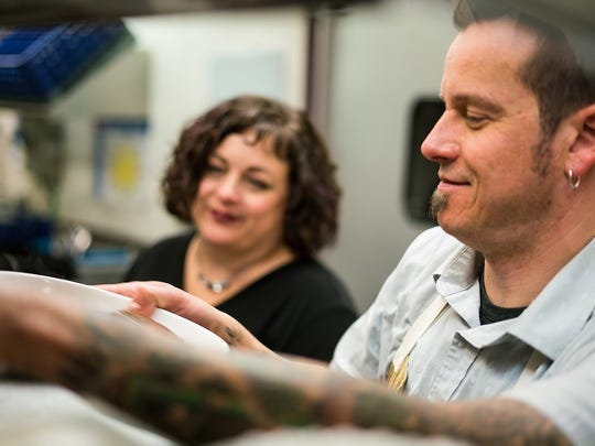 Jason and Cristina Tofte work together to ensure dishes served to guests are meeting their standards.