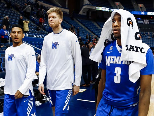 Memphis teammates Christian Kessee (from left), Chad