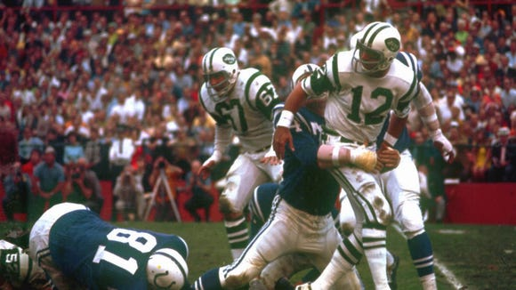 ADVANCE FOR WEEKEND EDITIONS JAN. 9-10--FILE--New York Jets quarterback Joe Namath (12) gets a pass away against the Baltimore Colts under pressure from a Colts defender, in Super Bowl III, in this Jan. 12, 1969 photo. The Jets won, 16-7. For every hopeless cause, every gloomy situation, every no-chance predicament, the 1969 Super Bowl victory by the New York Jets stands as a beacon of light, proof that sometimes the impossible is possible.(AP photo) ORG XMIT: NY155
