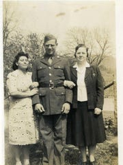 One of the photos of Army Pvt. Harry V. Nourse kept in a small leather wallet that was found among recycled waste at Garten Services. This one is presumed to be of him with his wife, left, and his mother on each arm.