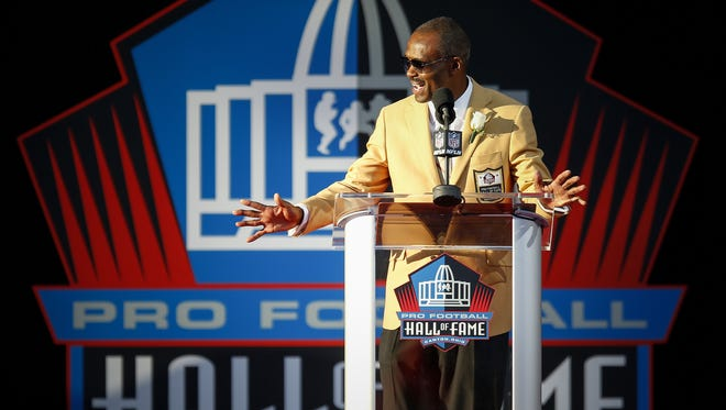 Former Indianapolis Colts wide receiver Marvin Harrison gives a speech during the NFL Hall of Fame Enshrinement Ceremony at Tom Benson Hall of Fame Stadium in Canton, Ohio, on Aug. 6, 2016.