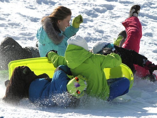 A trip down the sledding hill at Hartland's Hertitage