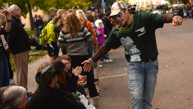 The parade marches along The Oval on Colorado State University's campus in this Coloradoan file photo. People parked along the parade route will need to move their cars Friday morning.