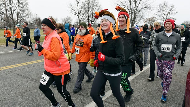 Runners set off on the 5K for the CentraCare Health Wishbone Run Thursday, Nov. 26 at Whitney Park. About 3,000 runners and walkers took part in the annual 1K and 5K runs.