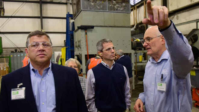 Congressman Bill Shuster, left, and State Rep. Rob Kauffman get a plant tour from Joe Danowski, right, at  Nursery Supplies, Inc., on Friday, April 8, 2016. NSI is a leader in the production and sales of nursery containers in North America. Guests toured the plant to see the latest manufaturing lines dedicated to processing recycled plastic.