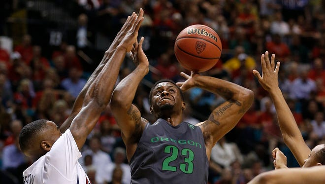 Arizona's Rondae Hollis-Jefferson, left, blocks Oregon's Elgin Cook during the first half of an NCAA college basketball game in the championship of the Pac-12 conference tournament Saturday, March 14, 2015, in Las Vegas.