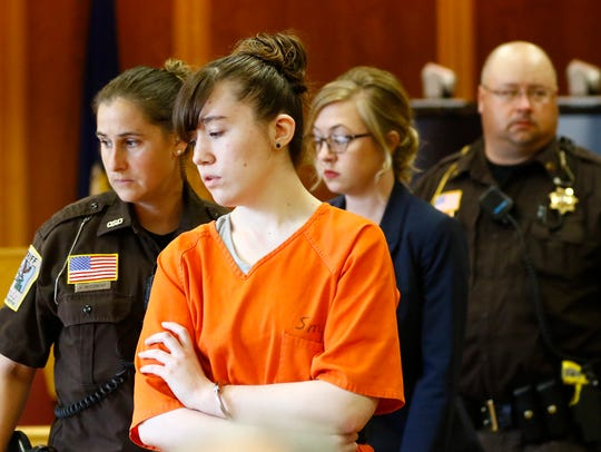 Ashlee Martinson returns to the courtroom after a recess
