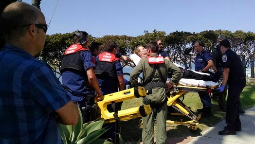 Paramedics evaluate a diver who was found unconscious Tuesday afternoon when he resurfaced near Anacapa Island.