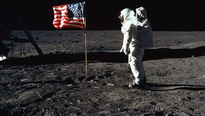On July 20, 1969, astronaut Buzz Aldrin, lunar module pilot of the first lunar landing mission, posed for a photograph beside the deployed United States flag during an Apollo 11 moonwalk. The Lunar Module is on the left, and the footprints of the astronauts are clearly visible.