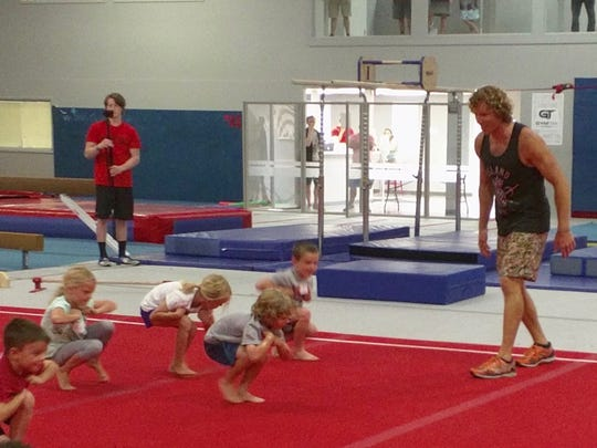 """Ninja Warrior Grant McCartney shows little ninjas how to move in unusual ways during his """"Ninja Clinic"""" in Knoxville on Sunday, May 21"""