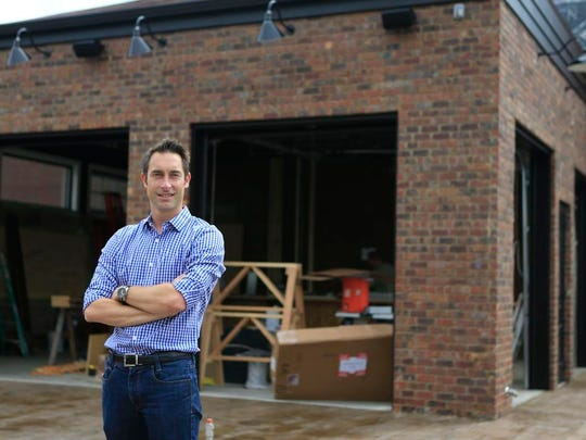 Ian Hall, owner of The Exchange Pub on Main Street in New Albany, is expanding to add an additional 75 seating capacity as well as another bar with indoor/outdoor seating. There will also be room for fire pits outside the popular pub. By Matt Stone, The C-J June 19, 2015