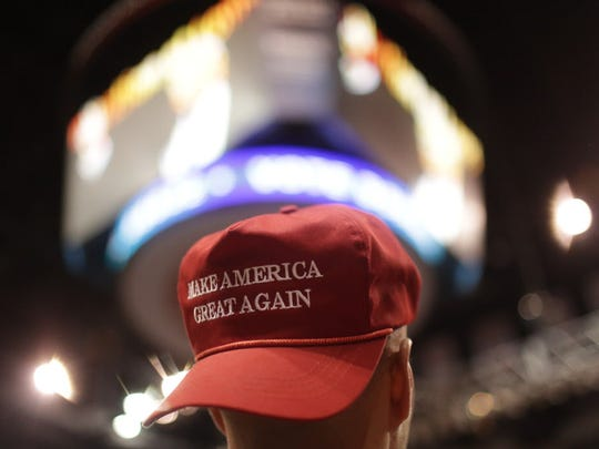 A supporter wears a Make America Great Again hat during